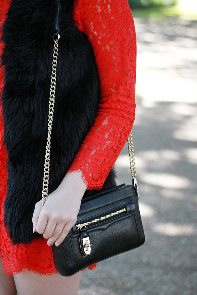 Red lace romper with a black fur vest