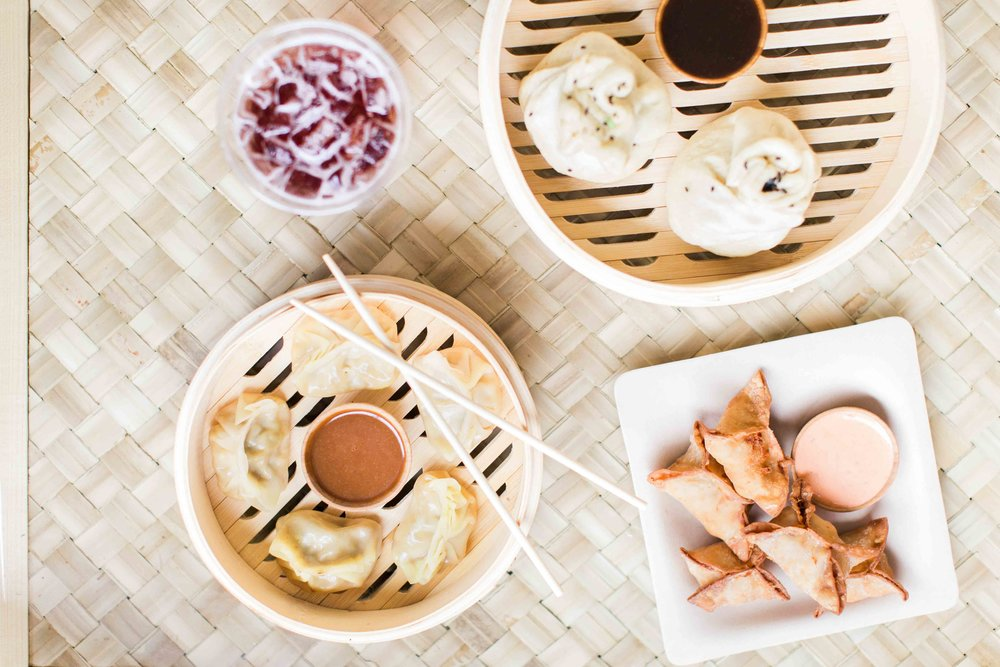 Dumpling-Darling-bao-buns-dumplings-table-spread.jpg