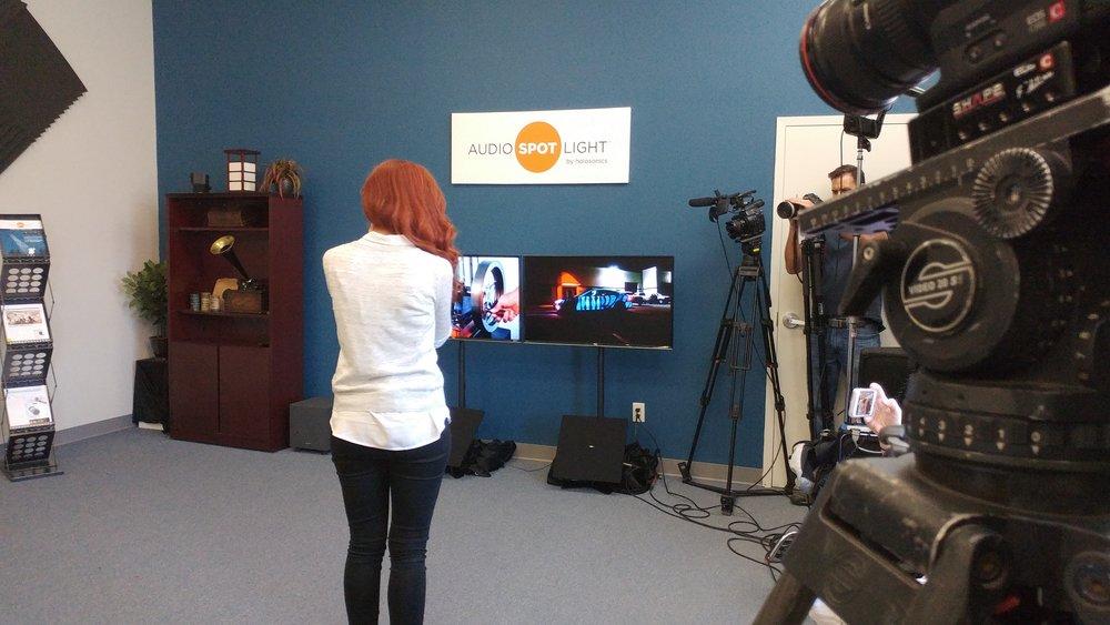 CBS correspondent Alie Ward gets a firsthand demonstration of Audio Spotlight technology