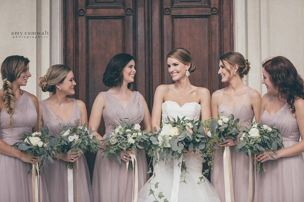 Dallas Scottish Rite Library and Museum wedding bridesmaids in taupe bridesmiad dresses and greenery and white bouquets
