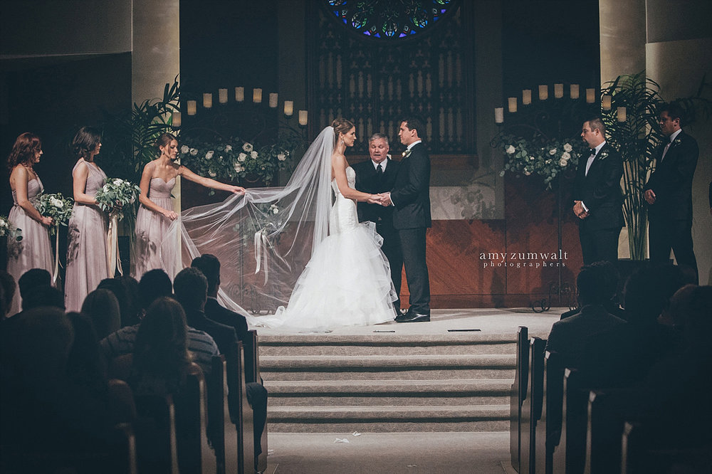 Dallas Baptist Church wedding altar with two large candelabras with greenery
