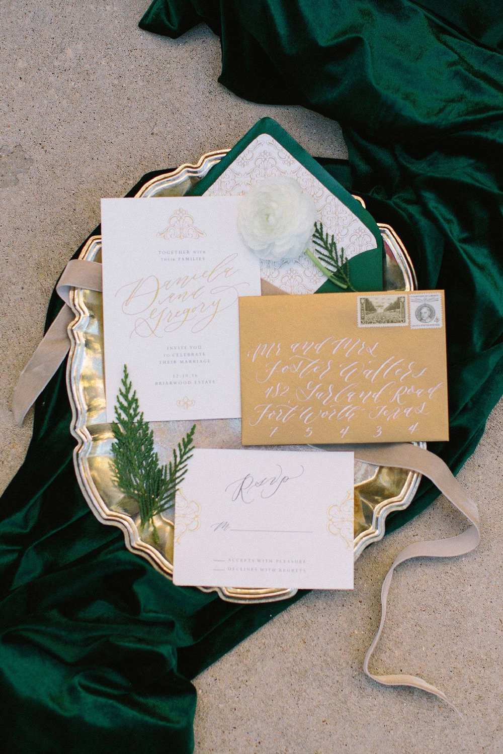 aristide mansfield wedding green and gold invitations on velvet green fabric