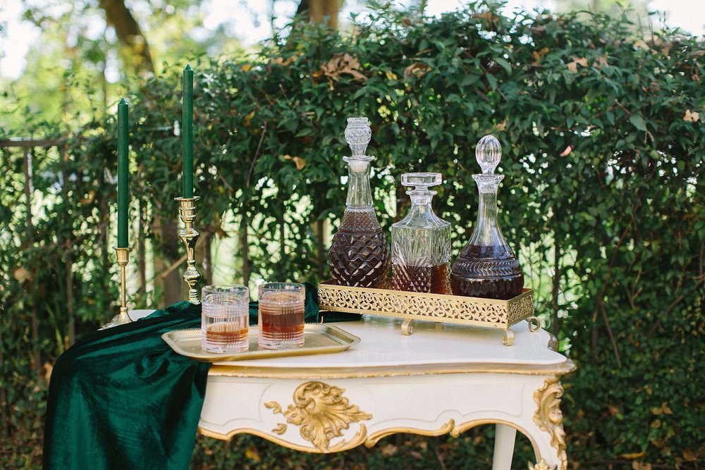 aristide mansfield wedding whiskey bar on white and gold table
