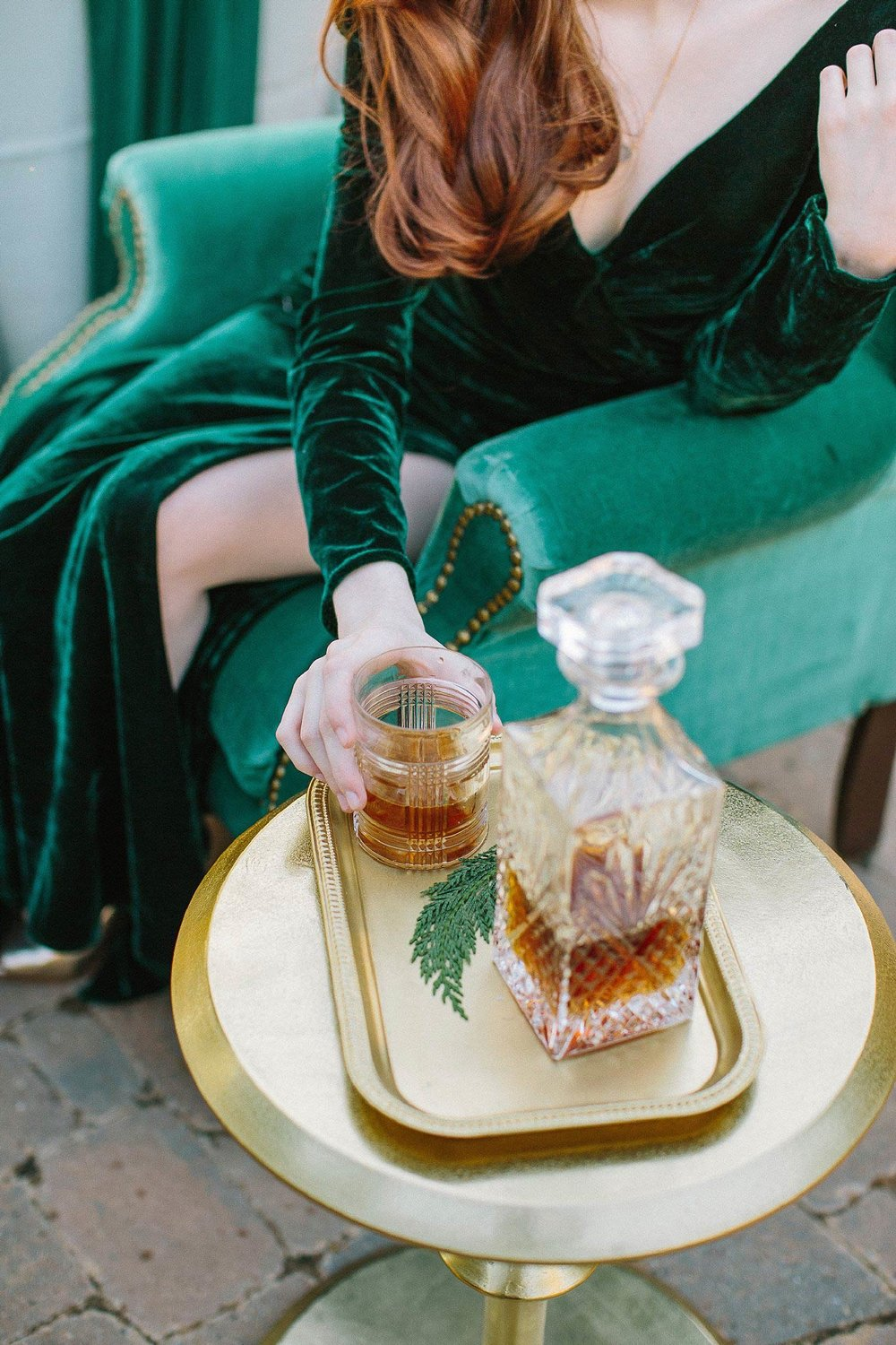 aristide mansfield wedding with green chair and whiskey