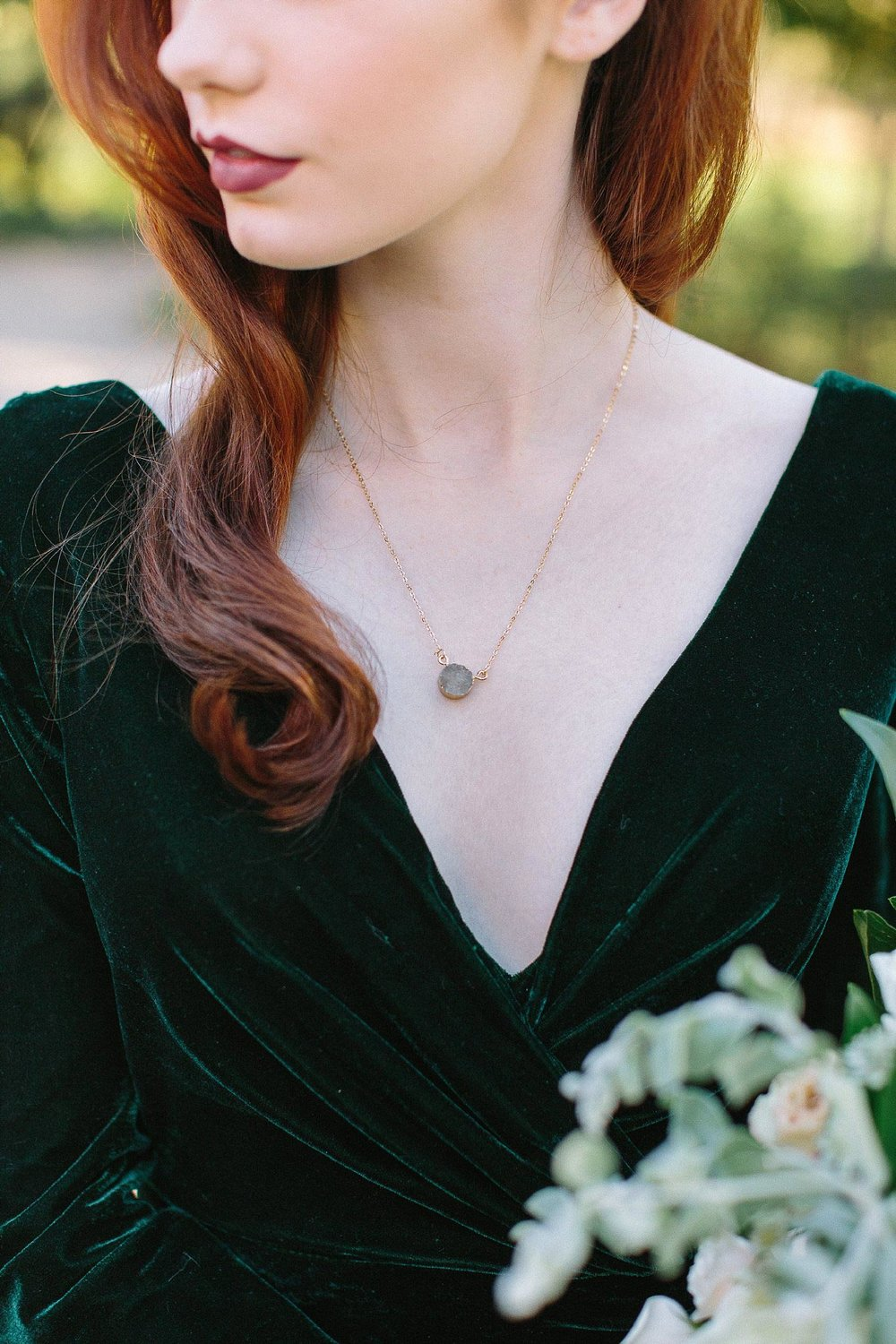 aristide mansfield wedding greenery dress with jewel necklace