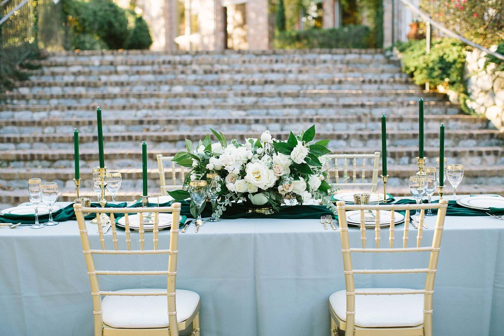 aristide mansfield wedding grey reception table with gold chivari chairs