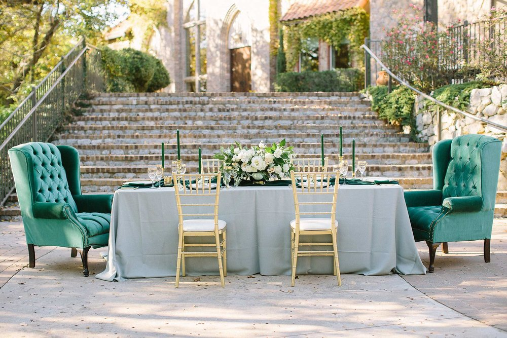 aristide mansfield wedding grey reception table with vintage chairs