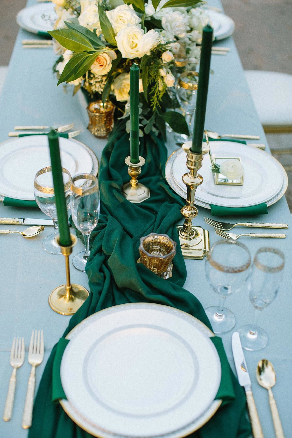 aristide mansfield wedding grey reception table with green runner and gold plates