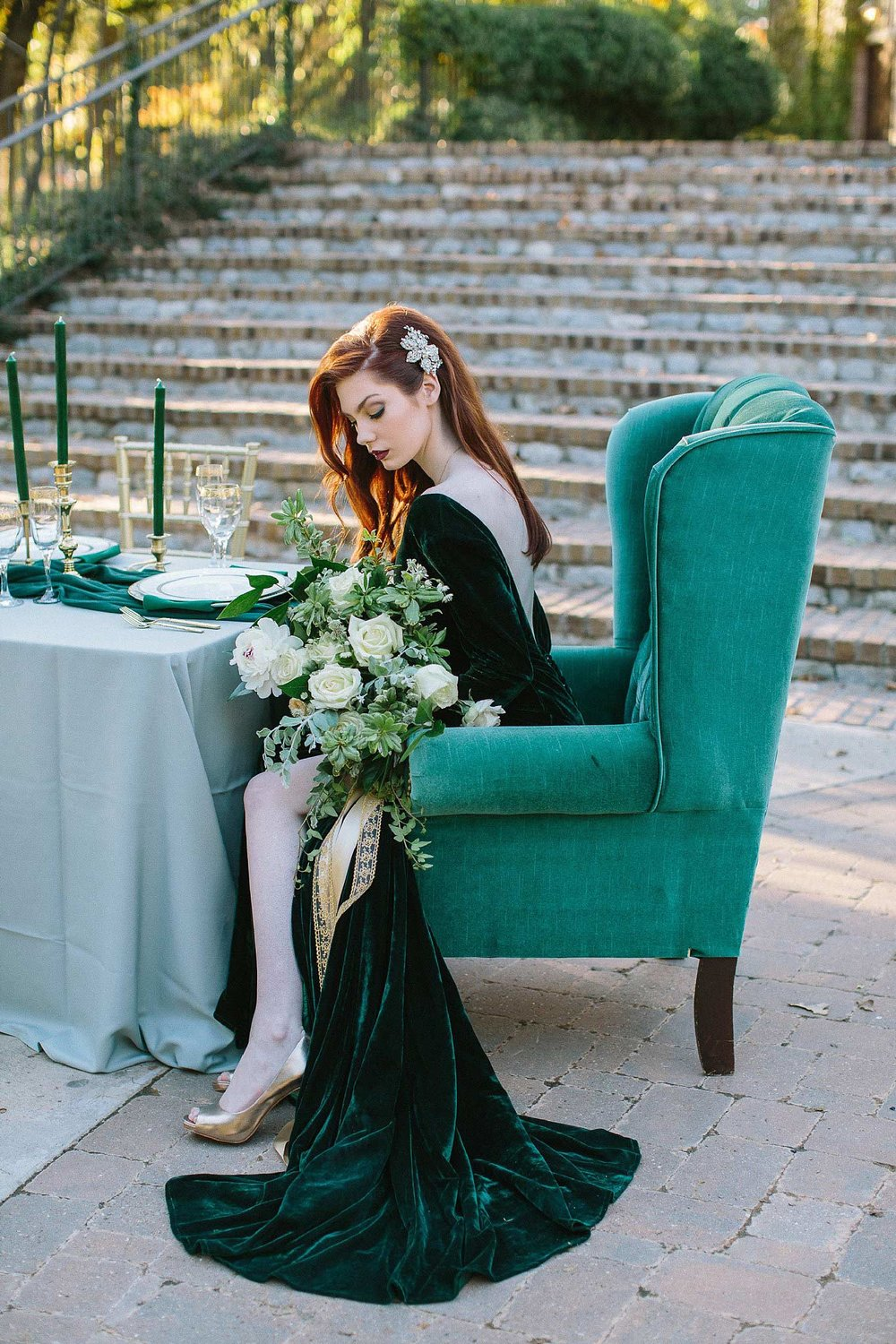 aristide mansfield wedding bridesmaid with green dress sitting at vintage green chair
