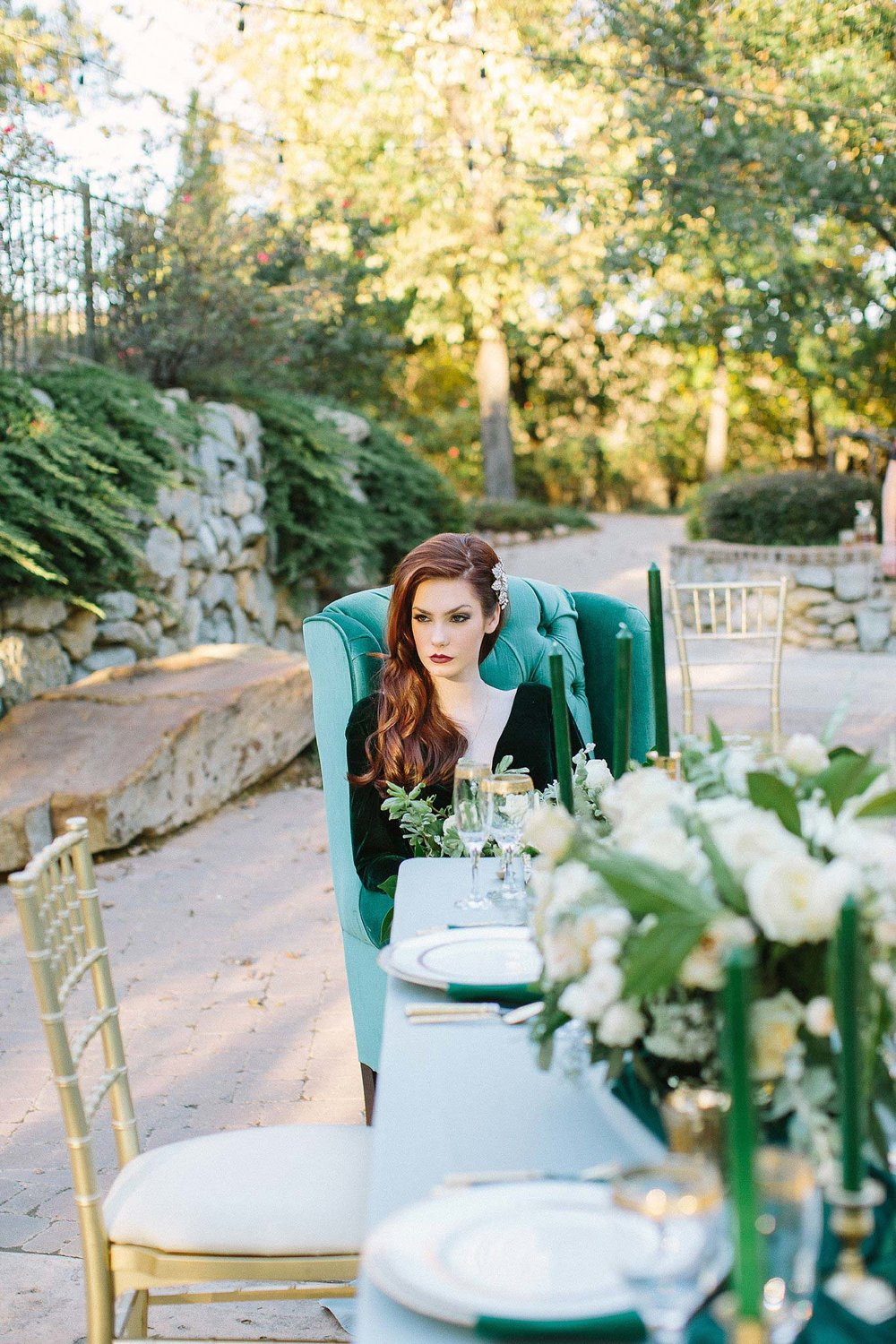 aristide mansfield wedding bride with red hair sitting at the end of the table