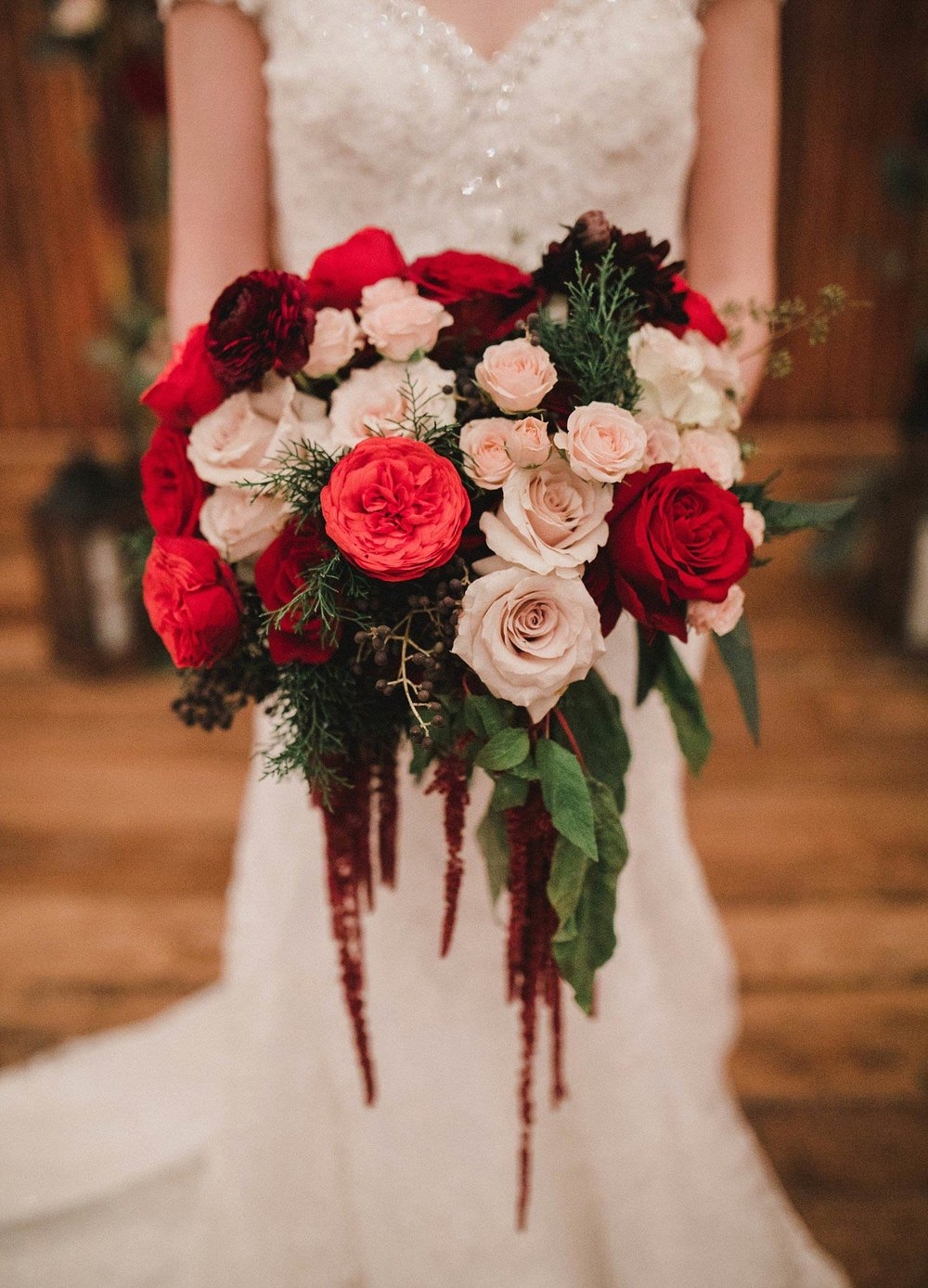 Hollow Hill Event Center wedding red cream and burgundy bridal bouquet