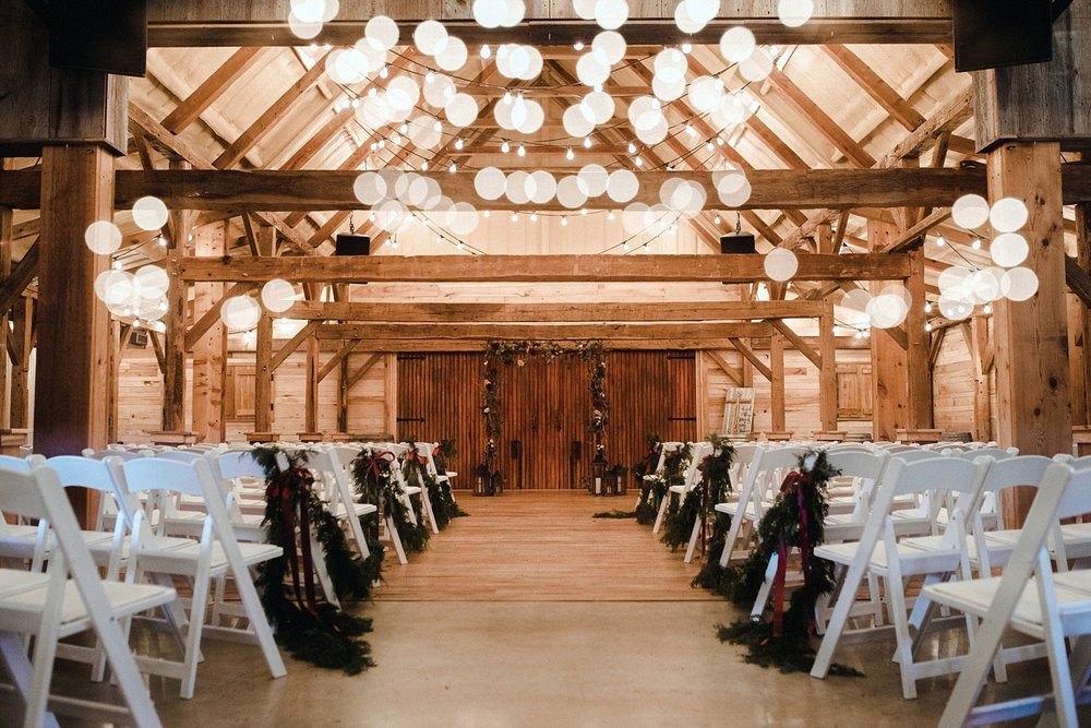 Hollow Hill Farm Event Center Wedding ceremony in wood barn