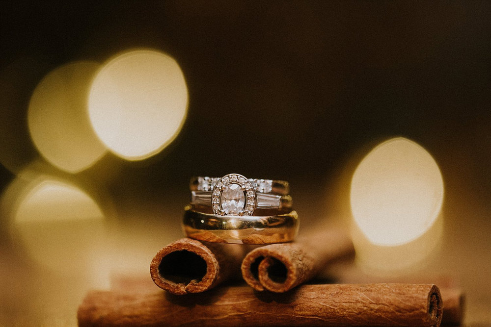 Hollow Hill Farm Event Center Wedding photo of rings on cinnamon sticks