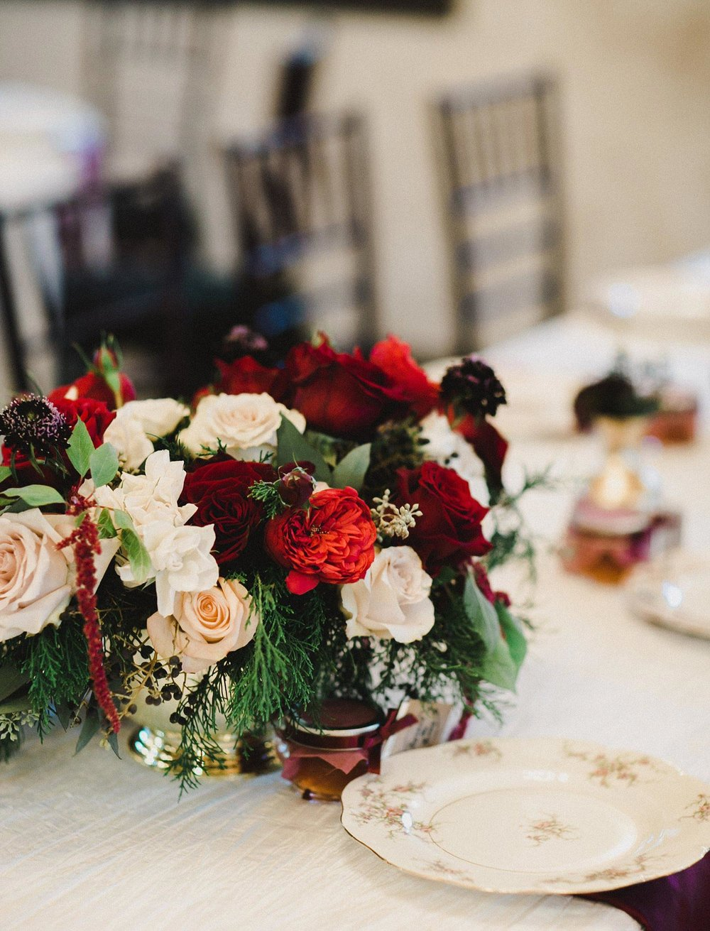 Hollow Hill Farm Event Center Wedding floral centerpiece with red, burgundy and cream roses