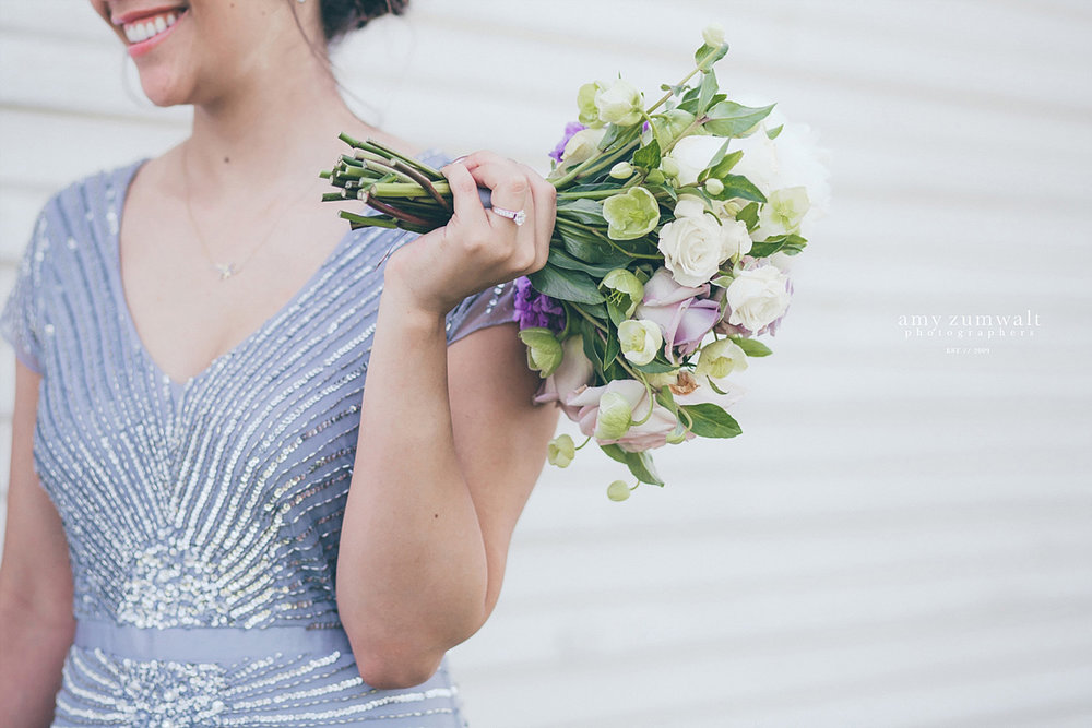 Brooks at Weatherford wedding bridesmaid holding lavender and white bouquet in sequin dress