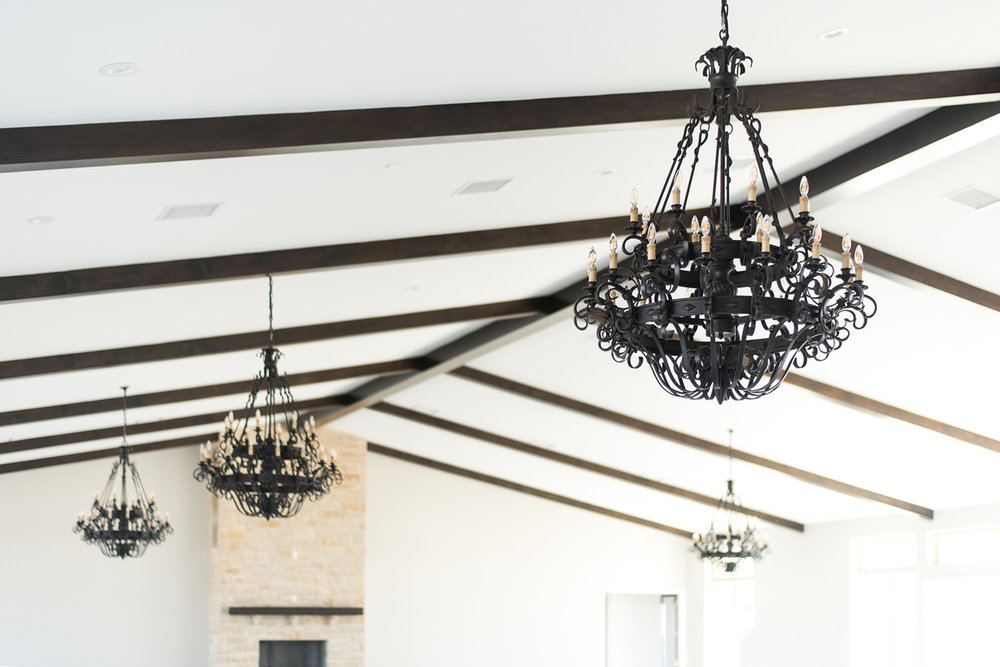 Dove Ridge Vineyard reception space iron chandeliers and grey walls