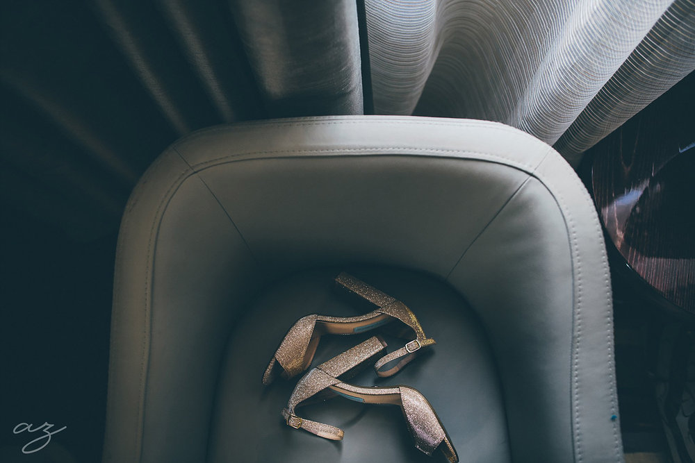 Bridal satin shoes in a leather chair at the Joule Hotel