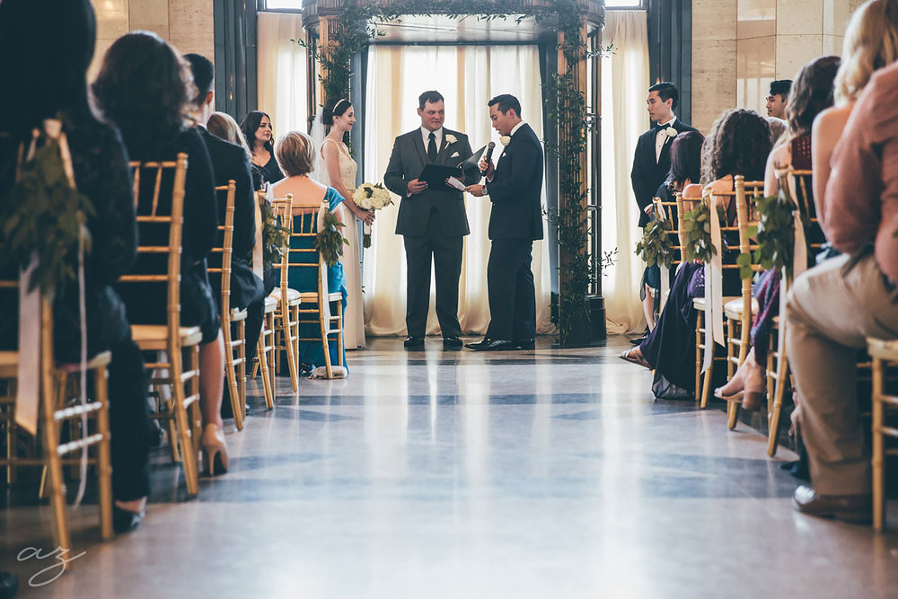 Carlisle Room wedding ceremony with greenery altar