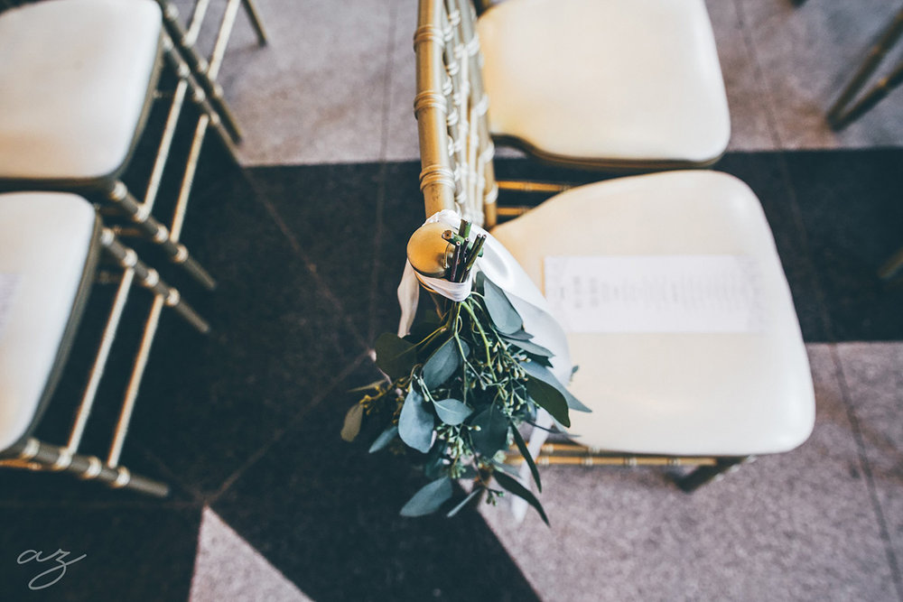 Carlisle Room wedding greenery on chivari chair
