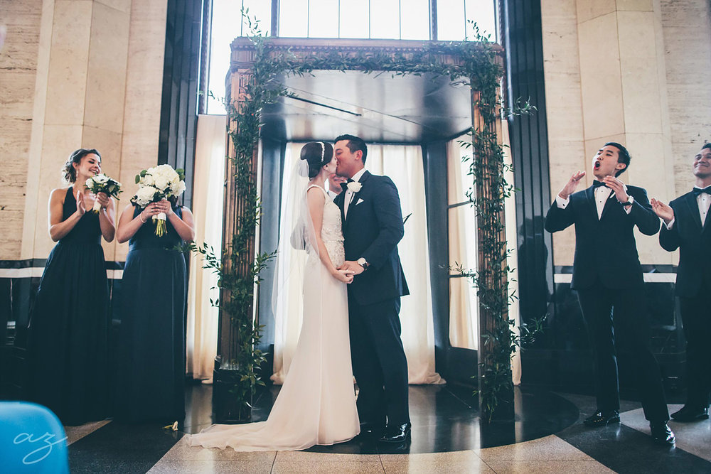 Carlisle Room wedding greenery altar and kiss