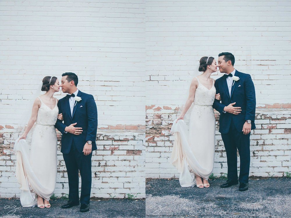 Bride and groom at industrial white brick wall