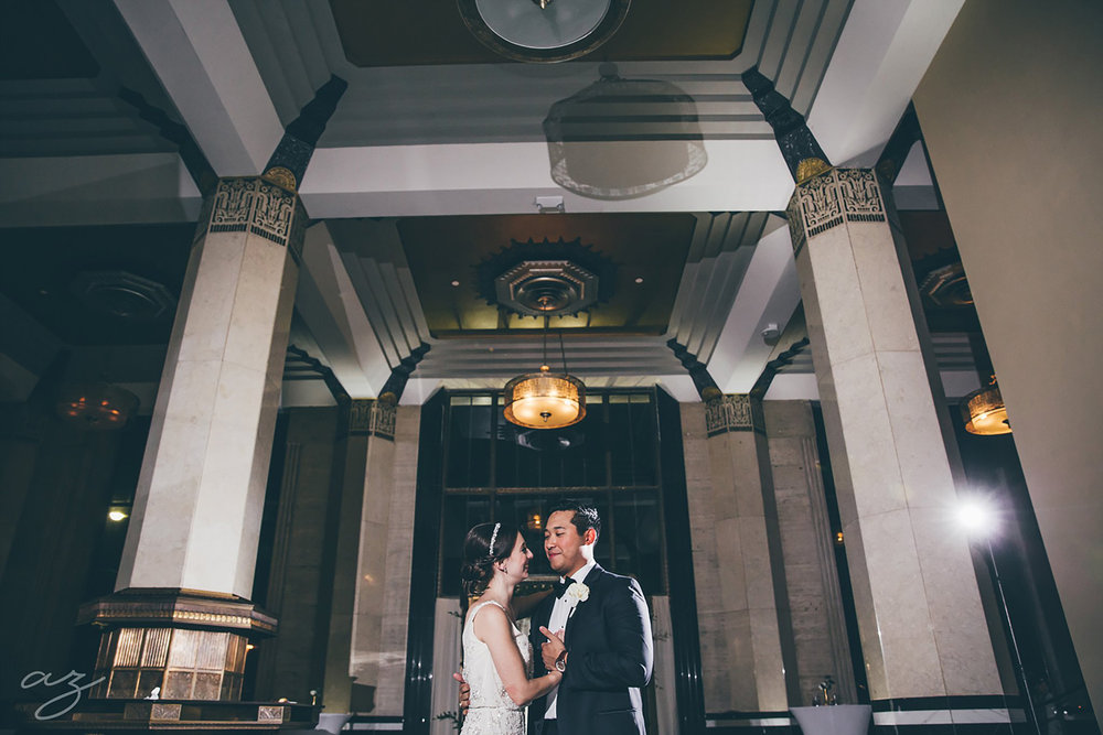 Carlisle Room wedding bride and groom dancing with tall marble columns and art deco