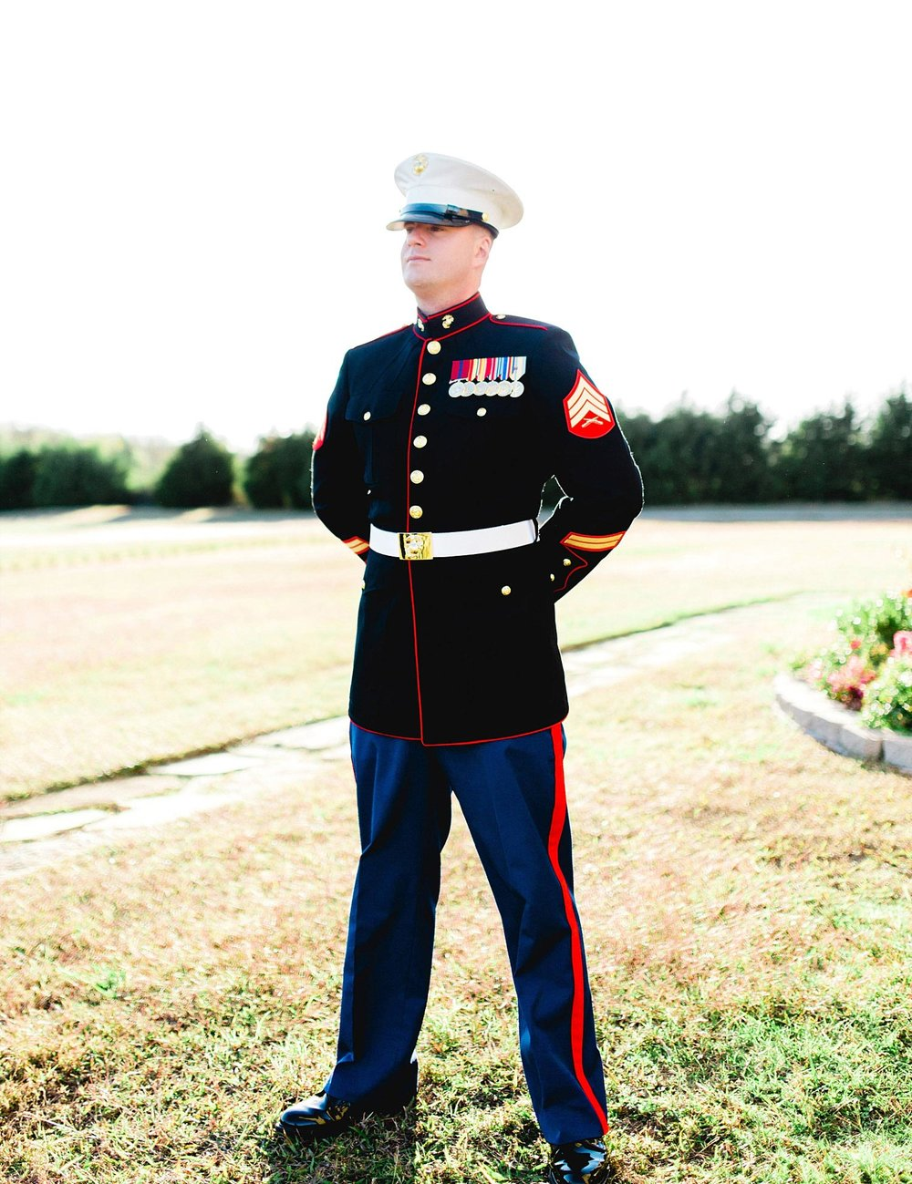 Castle at Rockwall wedding groom in marine uniform outside photo
