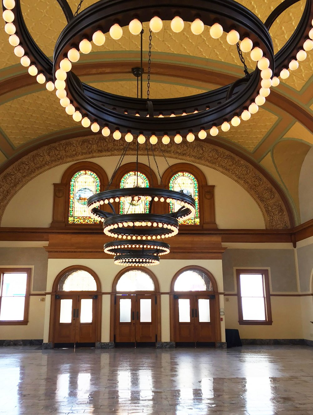 The Ashton Depot interior grand ballroom round chandeliers