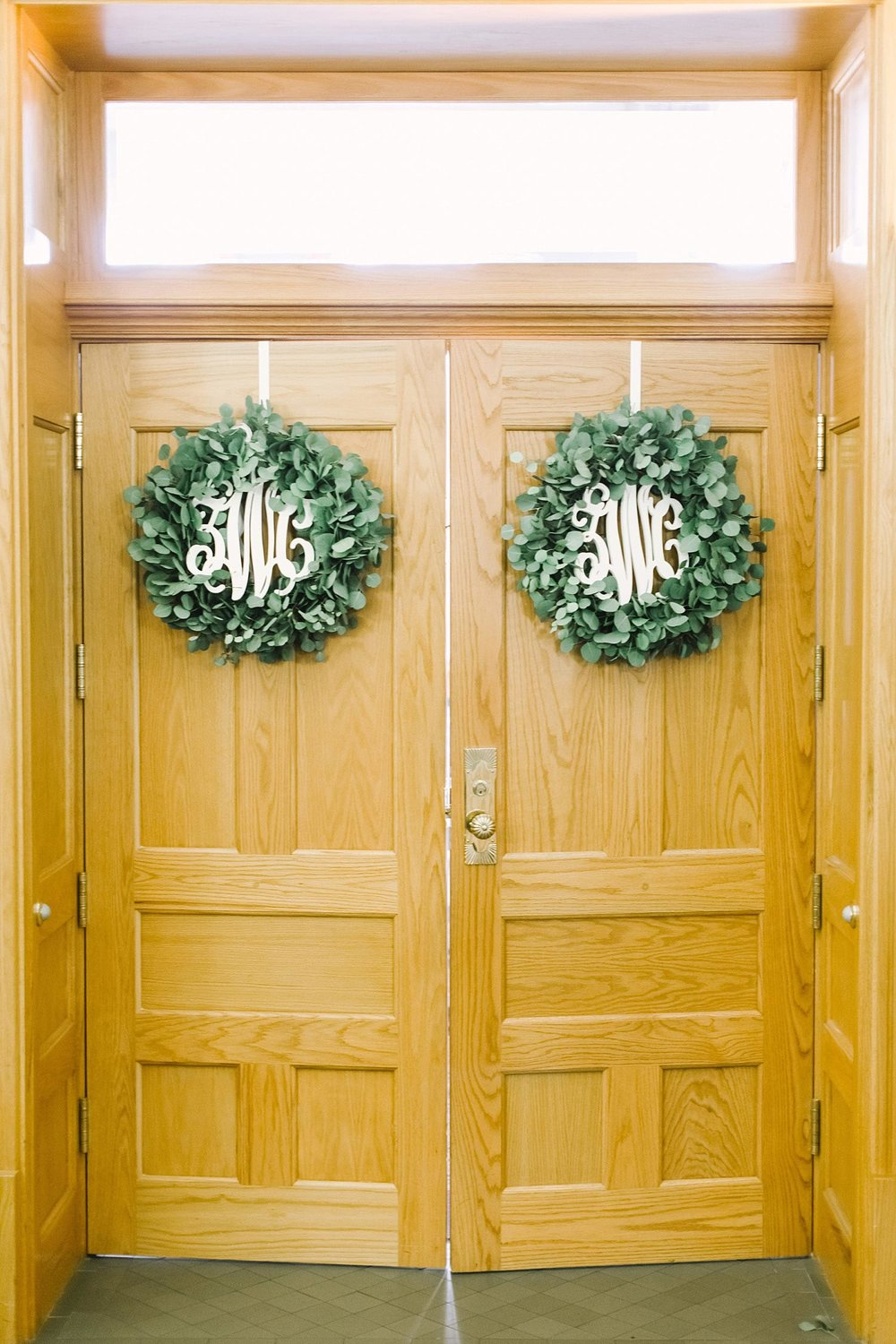 Old Red Museum wreaths on the ceremony doors with monograms in center