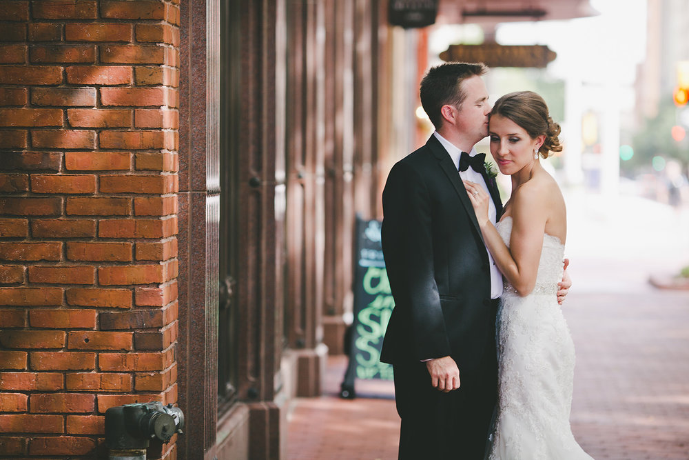 Fort Worth wedding bride and groom kissing in downtown