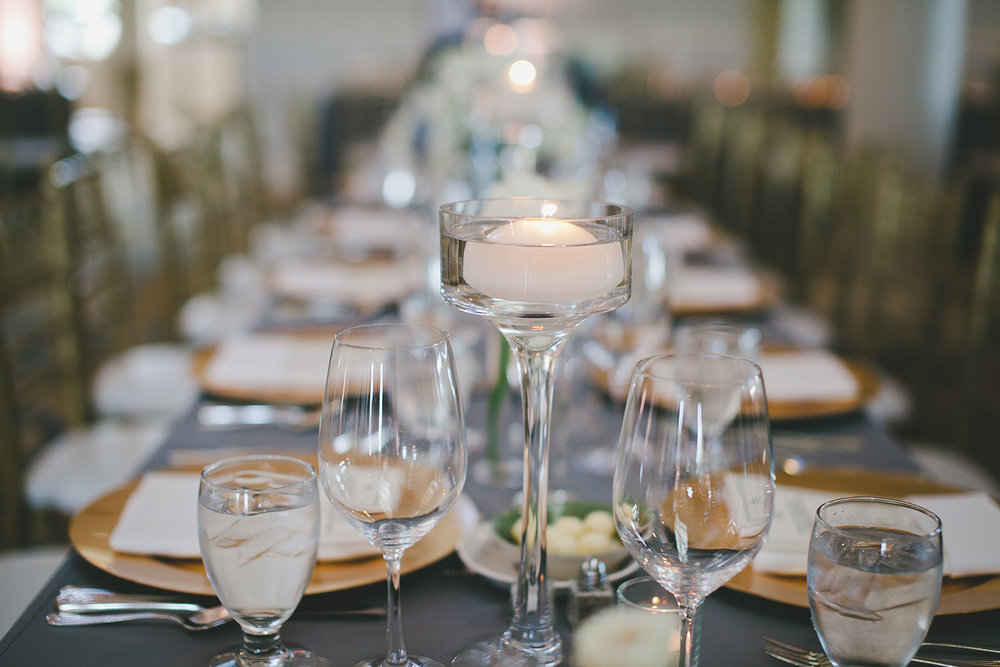 River Crest  country club wedding reception tables with grey linens and floating candles
