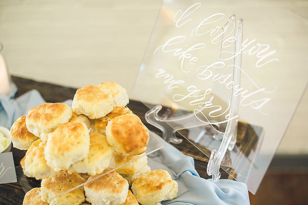 Acrylic signage for a southern wedding biscuit bar at Brik Venue