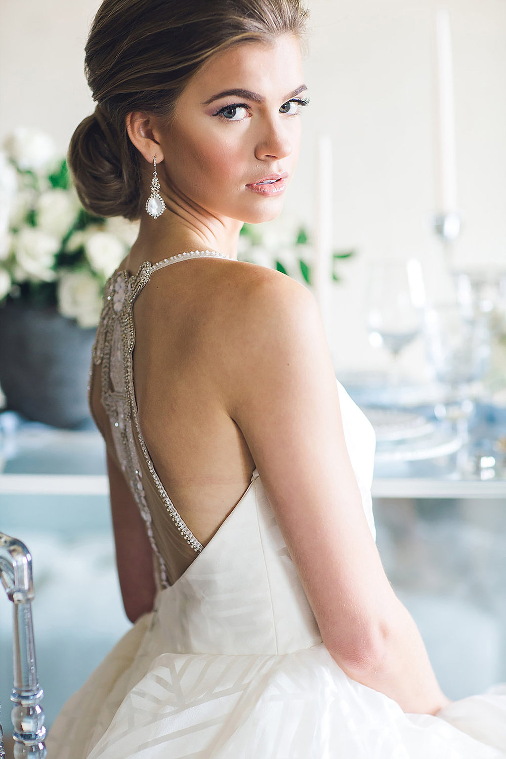 Bride wearing Haley Paige and Haute bride with a southern updo