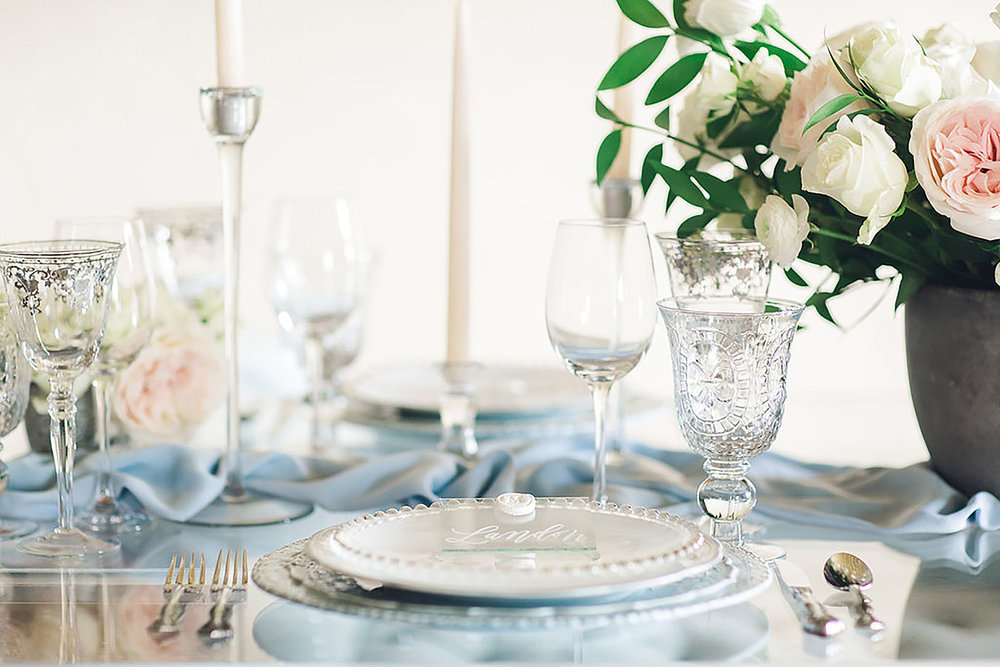 Light blue place setting with a vintage blue charger