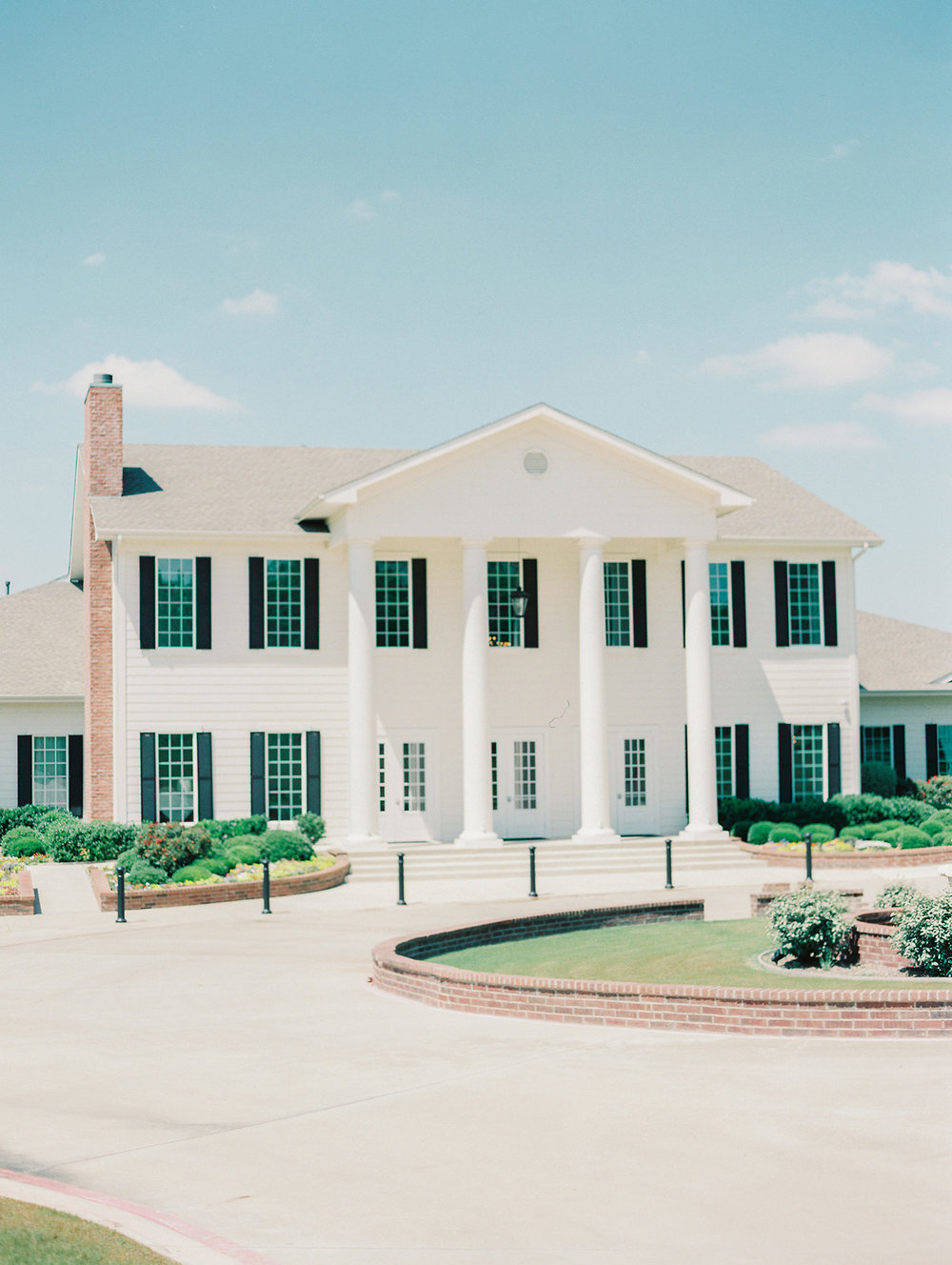 Southern white mansion with black shutters Texas wedding venue The Milestone