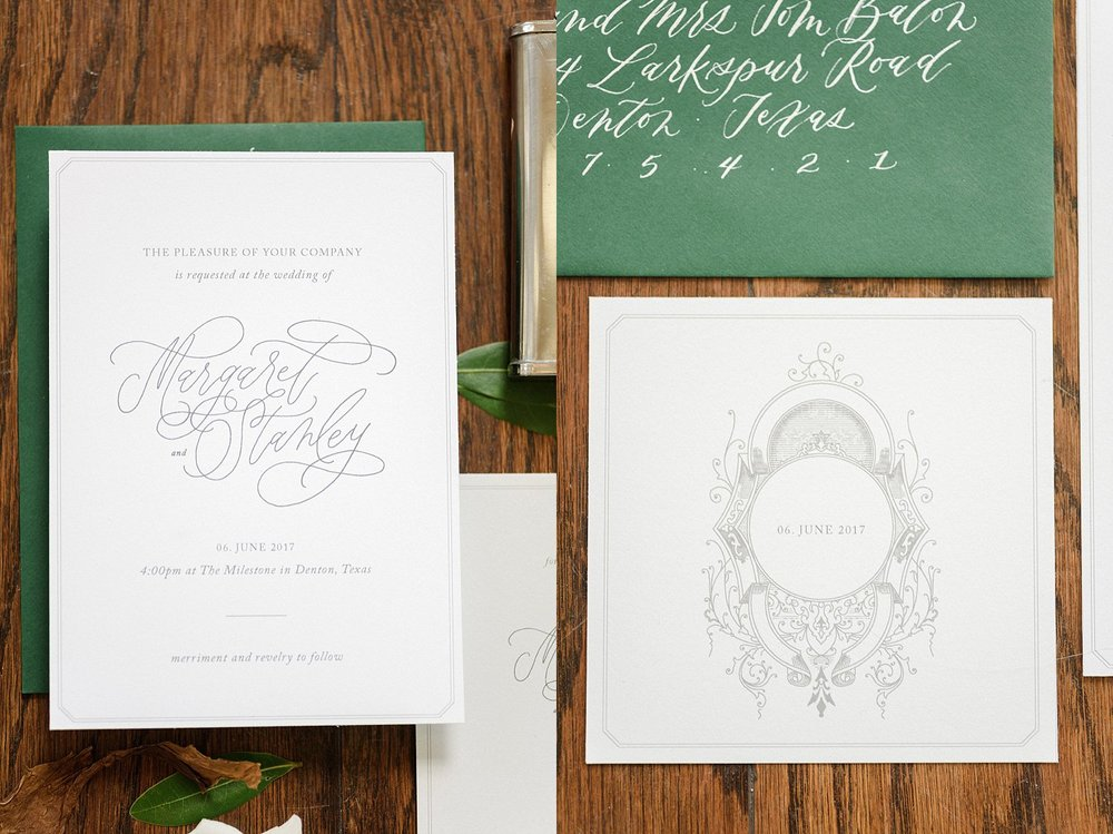 Wedding invitations with a green envelope and grey text on white paper