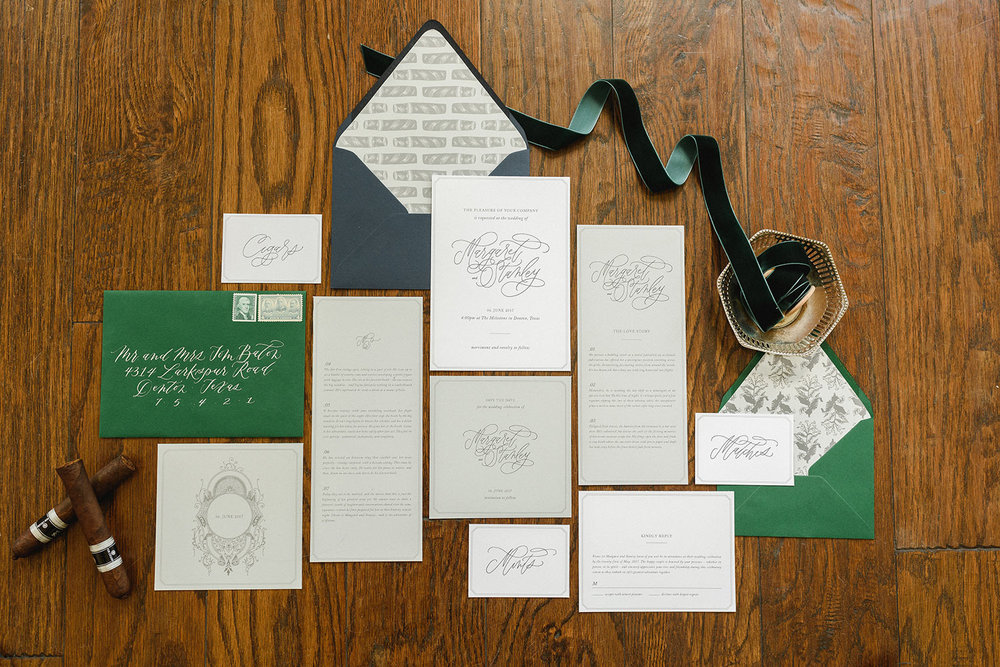 Green wedding invitation with cigars for a wedding at the Mileston in Denton TX