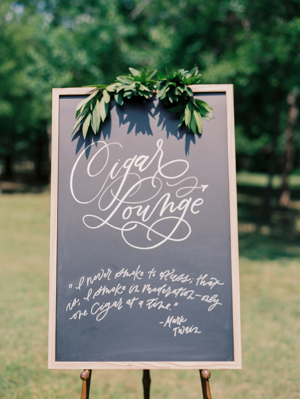 Chalkboard signage with a wood frame for a Cigar Lounge