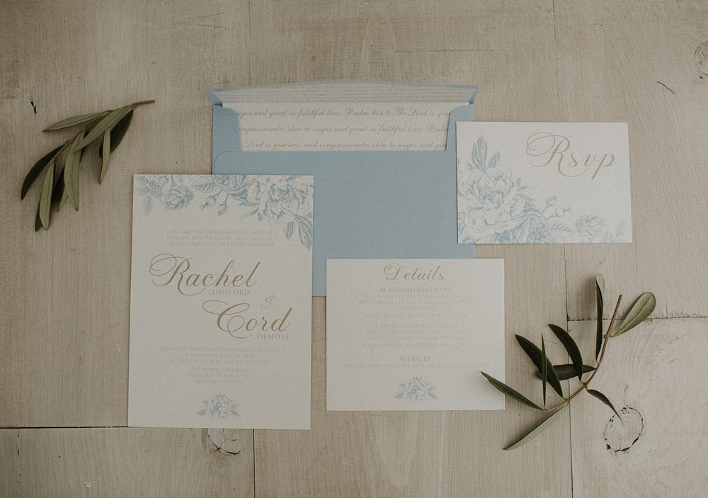 White Sparrow Barn dusty blue and ivory wedding invitations with a bible verse envelope liner and the french blue florals