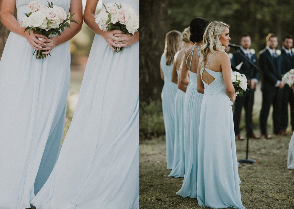 Light blue bridesmaid dresses holding blush flowers