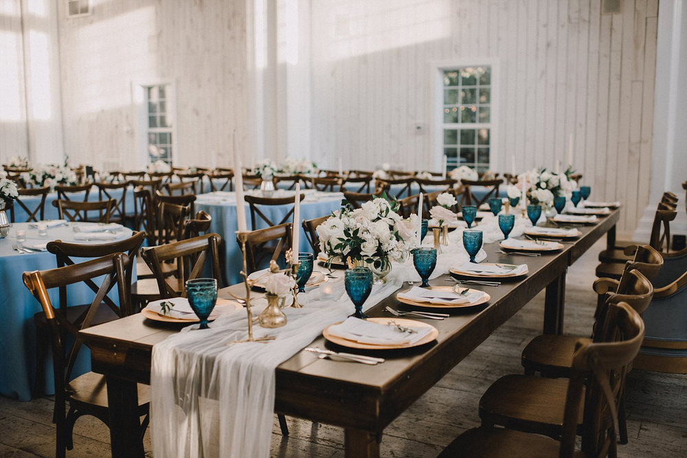 Wood farm table and white table runner at White Sparrow Barn