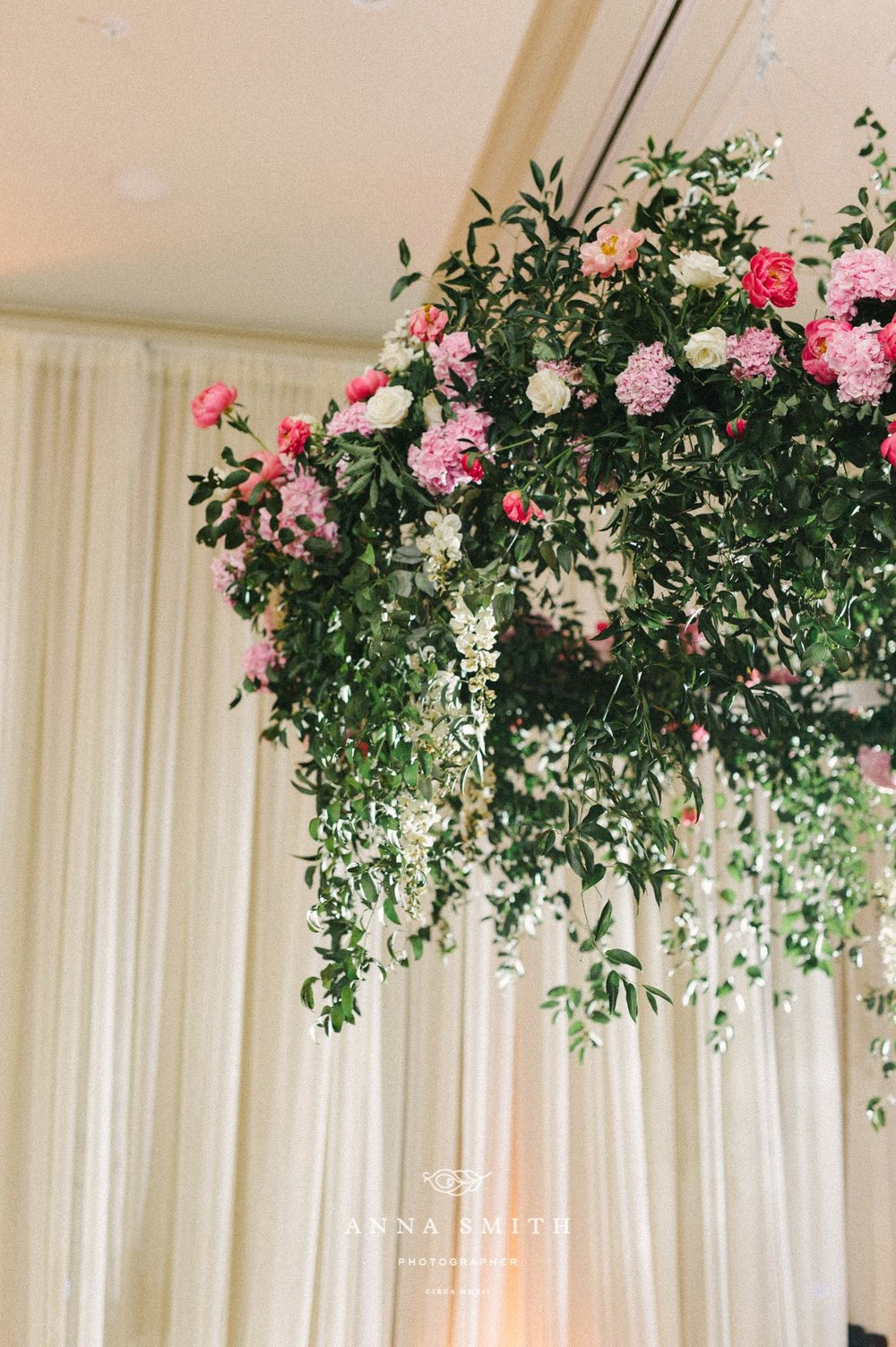 Pink flower chandelier with greenery