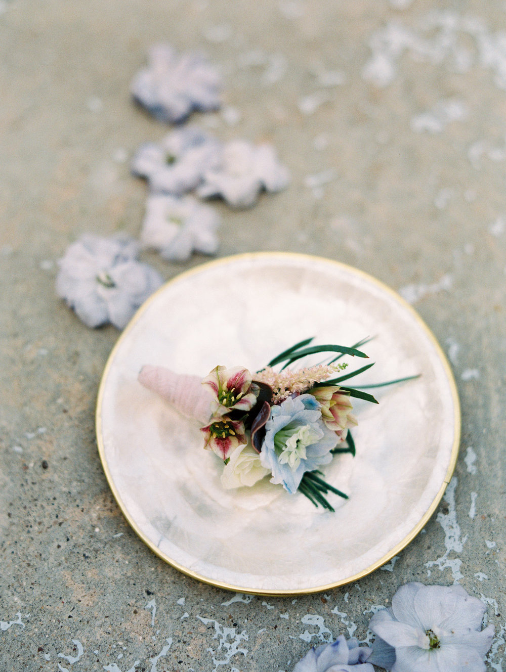 lavender boutinere on a white plate
