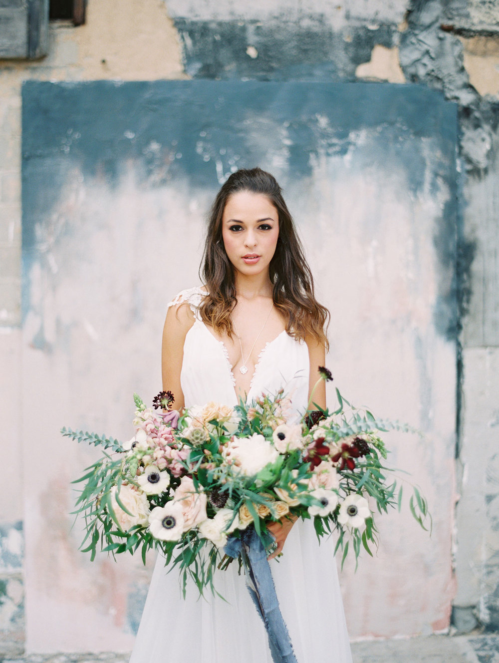 Bride at Post at River East in Fort Worth holding a bouquet
