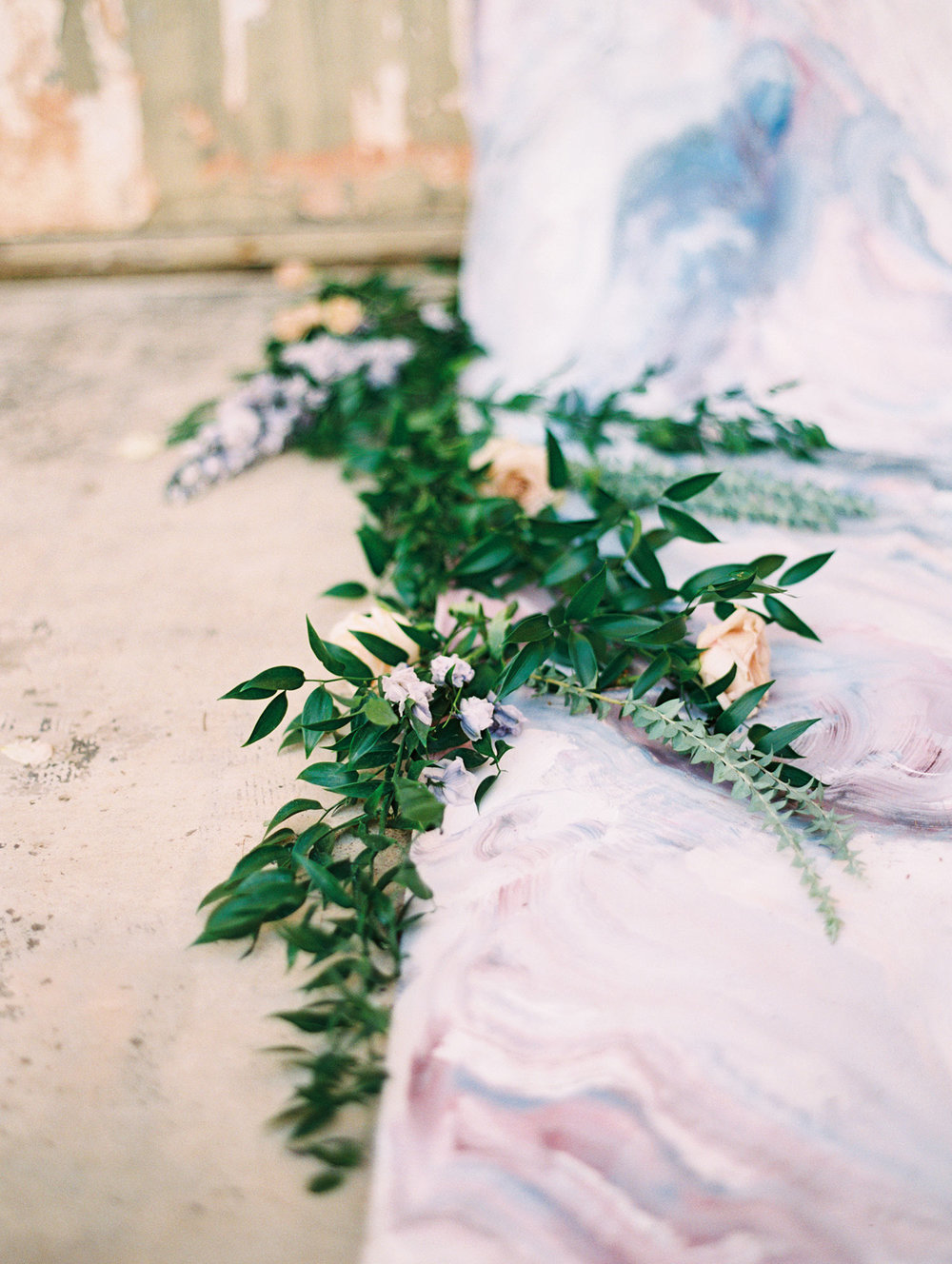 Greenery on wedding aisle with a marble runner