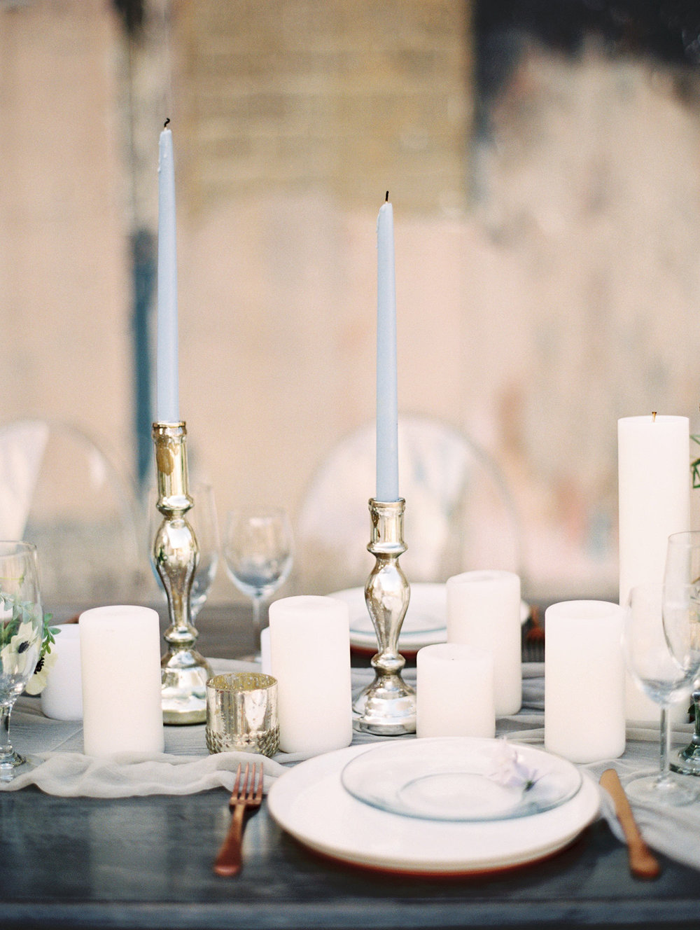 Pilar candles on a romantic white runner