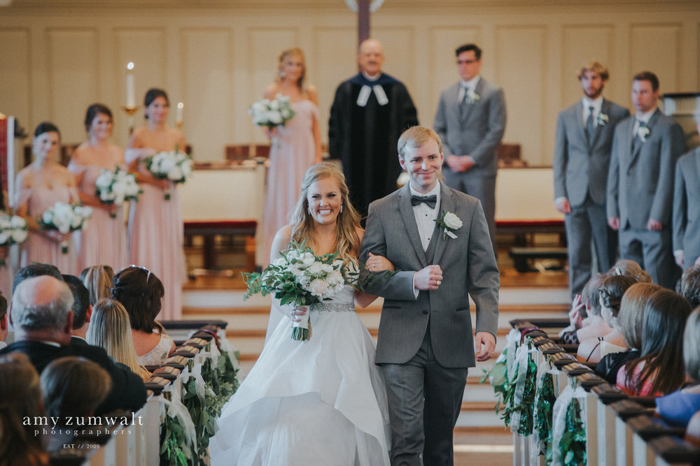Bride and groom walking down the aisle at first presbyterian church tyler