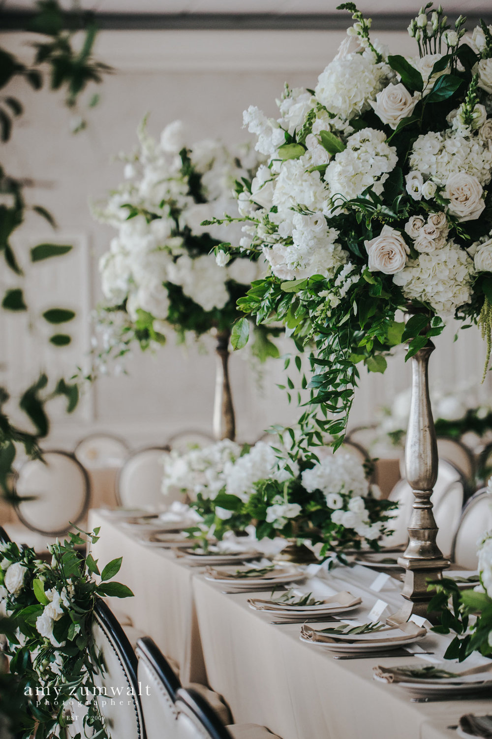 Tall white and green flower arrangements at head table of Willow Brook Country Club in Tyler