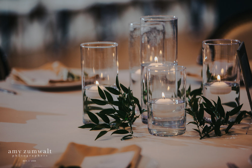 Candle centerpiece with greenery