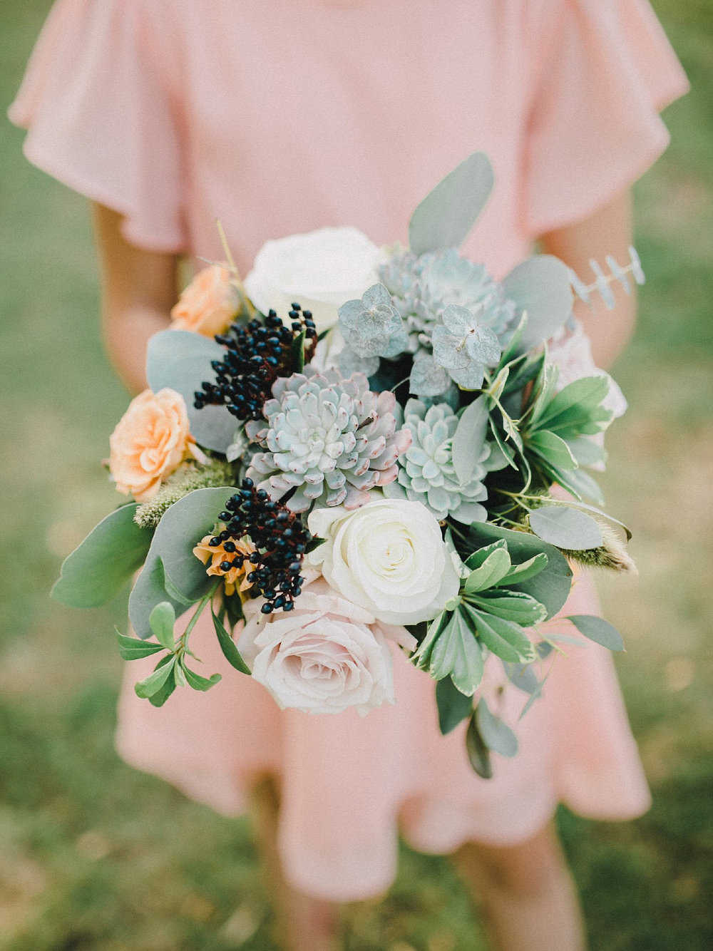Navy, apricot, white, and green bridesmaid wedding bouquet